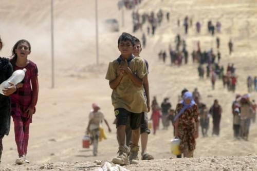 Cristiani iracheni in fuga dall'ISIS