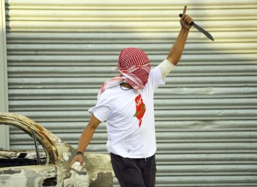 """""""E' la disperazione che nasce dall'illusione, alimentata per decenni e continuamente frustrata, di poter distruggere Israele"""". Sulla maglietta del palestinese, la consueta immagine della """"Palestina"""" che copre tutto il paese: Israele è cancellato dalla carta geografica"""